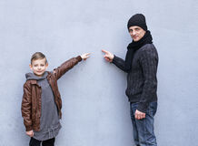 Man and boy father and son posing. On a gray background stock photos