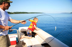 Man and Boy Fishing royalty free stock image