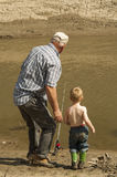 Man and boy fishing Stock Images