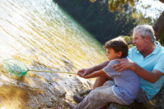 Man and boy fishing together Royalty Free Stock Image