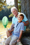 Man and boy fishing together Stock Image
