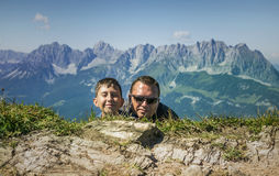 Man and boy hiding .Kitzbuhel peak,Austria. Stock Images