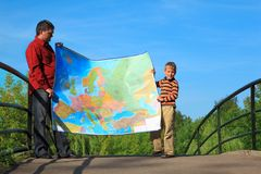 Man with boy they hold in hands  expanded map Stock Images