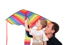Man and boy hold kite above head Royalty Free Stock Photography