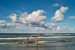 Man and boy in ocean surf Stock Photo