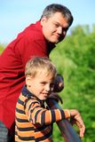 Man and boy outdoor in summer Stock Photo