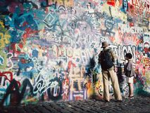Man and Boy Painting the Wall stock image