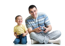 Man and boy play with a playstation together Royalty Free Stock Images