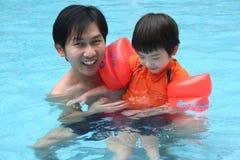 Man & boy in the pool Stock Photo