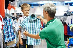 Man and boy shopping clothes Royalty Free Stock Images