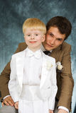 Man and boy in suits Stock Photography