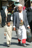 Man with a boy on traditional clothes at Sana on Yemen Royalty Free Stock Photography