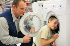 Man and boy with washing machine Royalty Free Stock Photo