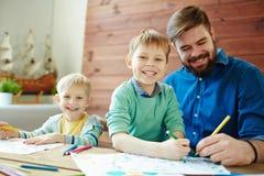 Man and boys drawing Stock Photos