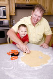 Man and boys making cookies Stock Image