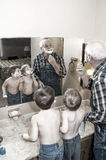 Grandpa and boys shaving faces Royalty Free Stock Photography