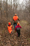 Man and boys walking with their guns  on a practice deer hunt Royalty Free Stock Photo