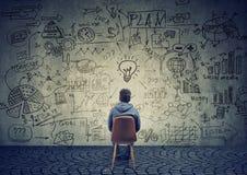 Man brainstorming on business plan Stock Image