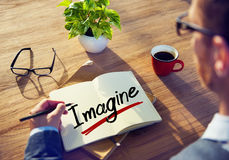 A Man Brainstorming about Imagine Concept Stock Photo