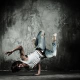 Man brake dancing. Young b-boy man doing brake dancing movements Royalty Free Stock Image