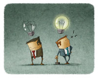 Man brake other man's bulb Royalty Free Stock Photos