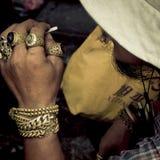 Man with brass bracelet smoking Stock Photography