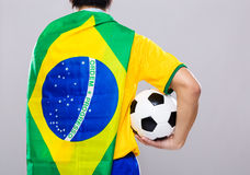 Man with Brazil flag and hold soccer ball Stock Photos