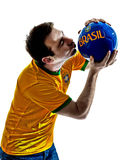 Man Brazilian Brazil kissing soccer ball Stock Image