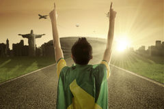 Man with Brazilian flag raises his hands Stock Photography