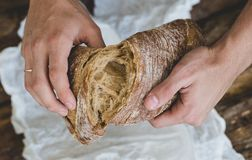 Man with bread Stock Images