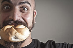 Man with bread in his mouth Stock Photos
