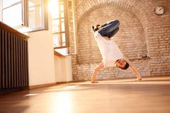 Man break-dancer doing handstand on hands Royalty Free Stock Image