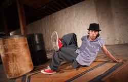 Man Break Dancing. Handsome Mexican man performs break dancing moves royalty free stock image