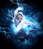 Man break dancing on electricity light background Stock Images