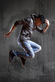 Man break dancing on wall background Royalty Free Stock Images