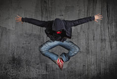 Man break dancing on wall background. Young man break dancing on wall background royalty free stock images