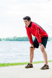 Man at break from running in front of lake Royalty Free Stock Photo