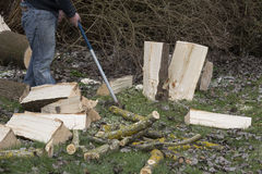 Man break wood with hammer Stock Photography
