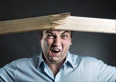 Man break wooden strip Royalty Free Stock Image