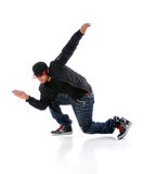 Man Breakdancing. African American dancer performing breakdancing isolated over white Stock Photo