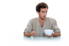 Man with a breakfast bowl Royalty Free Stock Photos