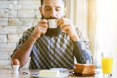 Man with breakfast and cup of coffee stock images