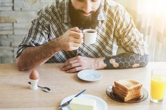 Man with breakfast and cup of coffee royalty free stock photography