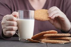 Man breakfast with Middle Eastern Sesame Cookies. And milk Royalty Free Stock Photos