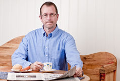 Man at breakfast table Royalty Free Stock Photography