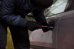 Man breaking into the car Royalty Free Stock Images