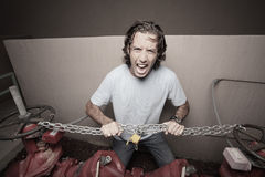 Man breaking the chains Stock Photo