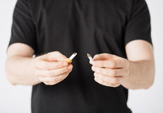 Man breaking the cigarette with hands Stock Photos