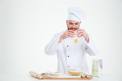 Man breaking eggs into a bowl for baking Royalty Free Stock Photo