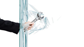 Man breaking glass Royalty Free Stock Image